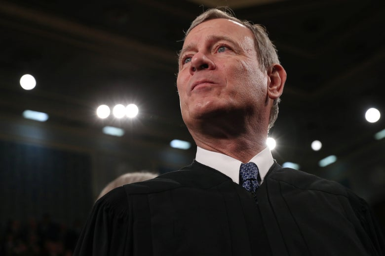 John Roberts looks up and off to the side.