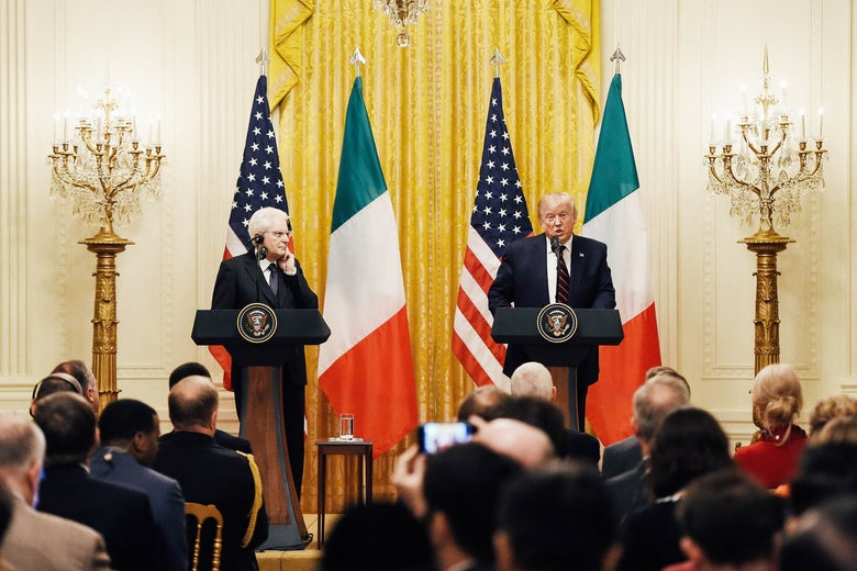 Trump and the Italian president at podiums in front of American and Italian flags.