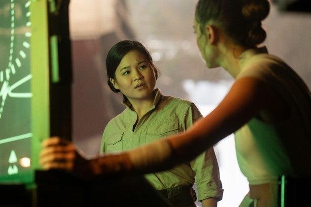 Kelly Marie Tran's Rose Tico in front of a glowing radar screen, with Daisy Ridley's Rey looking on.