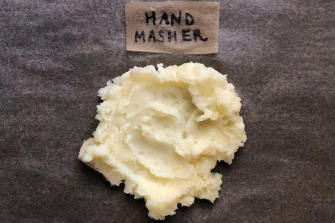 A dollop of mashed potatoes labeled Hand Masher.