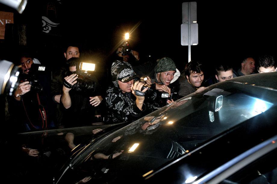 Paparazzi attempt to shoot Leonardo DiCaprio as he leaves Club Villa on his birthday in Los Angeles, Nov. 14, 2008.