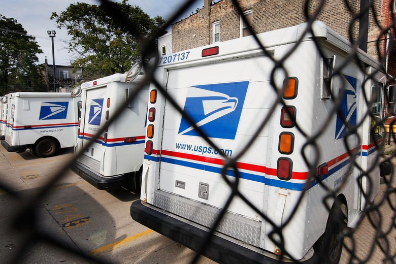 US Postal Service Trucks sit outside Roberto Clemente Post Office August 25, 2009 in Chicago, Illinois.