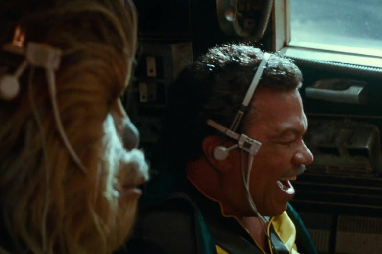 Chewbacca and Lando in the cockpit of the Millennium Falcon, in a still from Star Wars: The Rise of Skywalker.