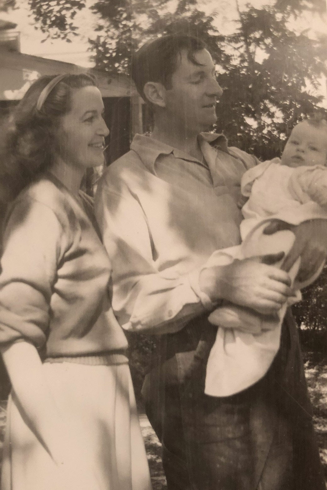 Elva P. Higgins with husband and first child.