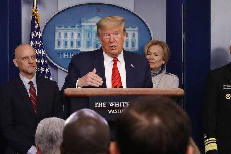 Trump speaks at the podium in the White House press room