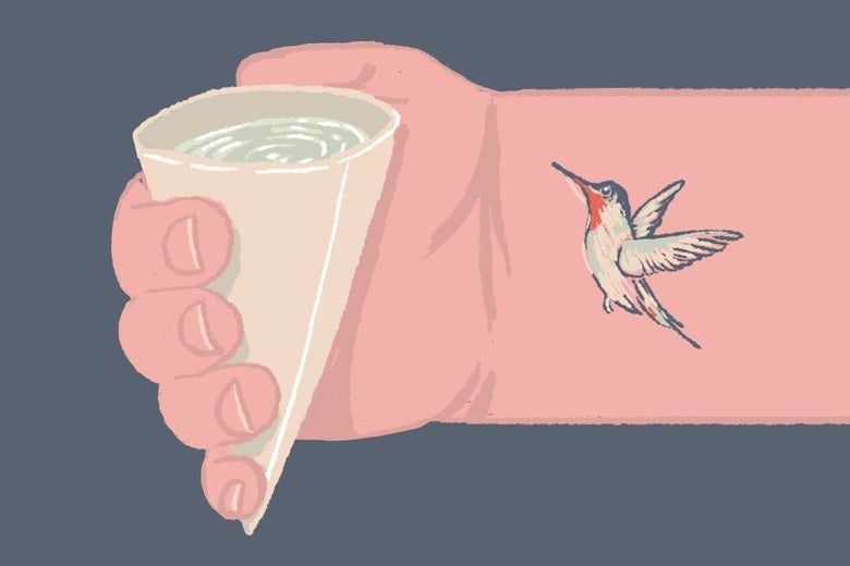 A hand—whose forearm has a hummingbird tattoo—holding a watercooler cup