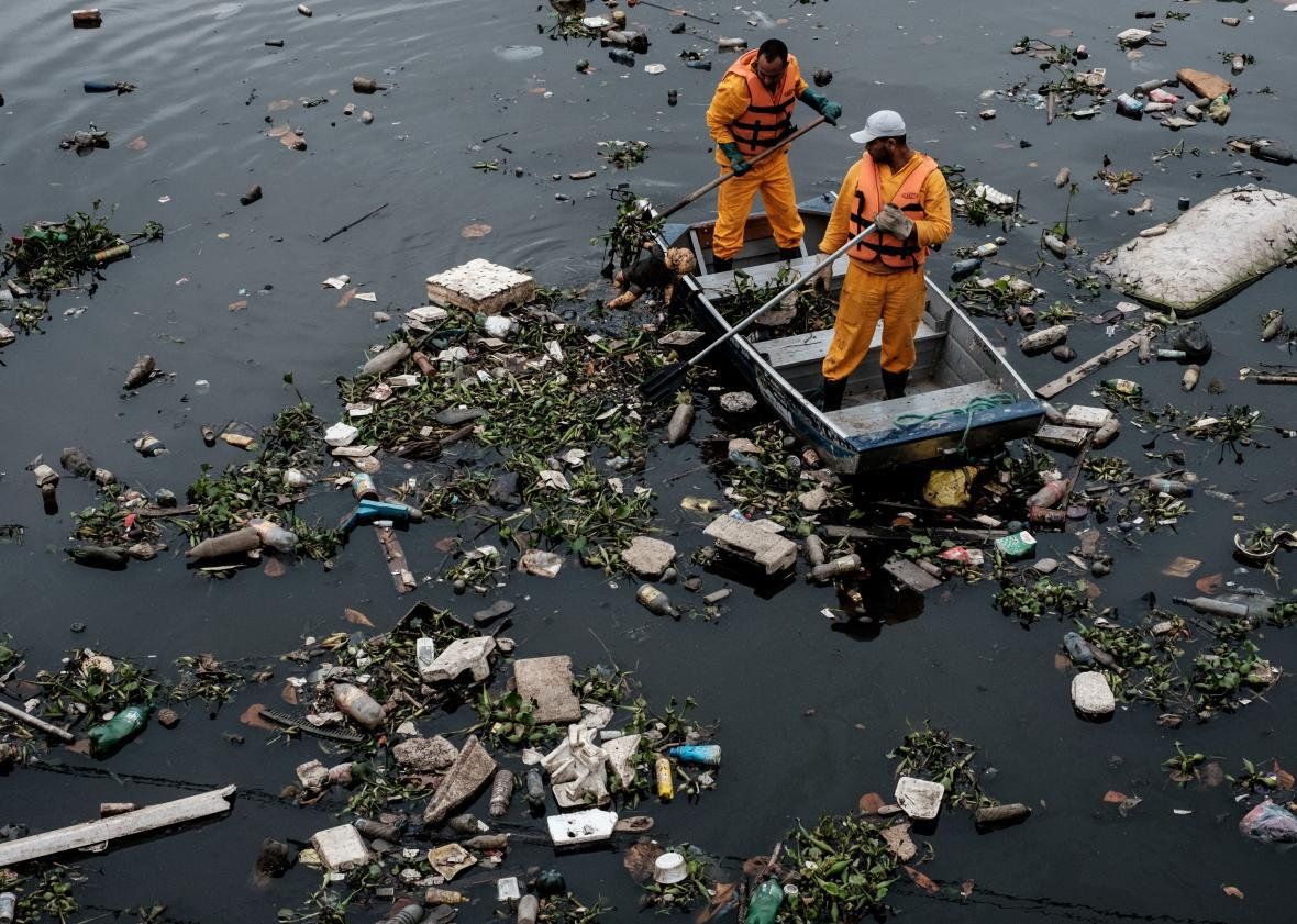 Floating debris caught by the eco-barrier before entering Guanabara Bay, at the mouth of Meriti River near Rio de Janeiro on July 20.