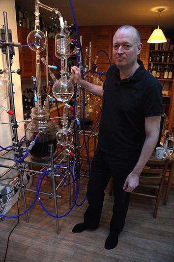 Ian Hart distilling Sacred Gin.