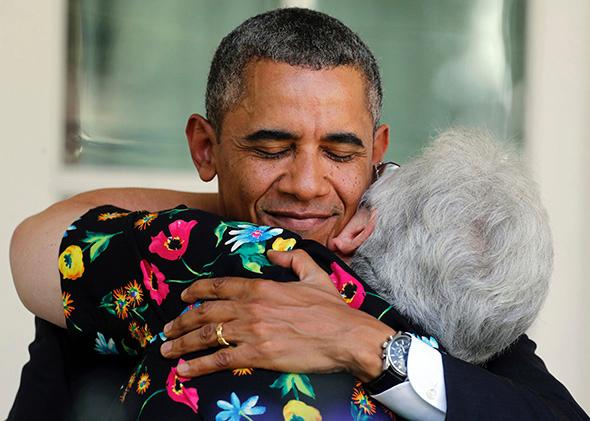 Obama hugging a woman who will benefit from the Affordible Care