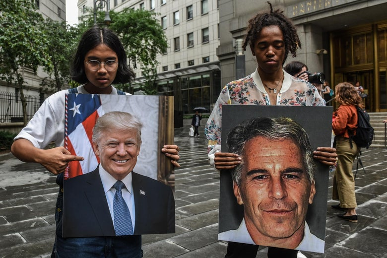Protesters hold up photos of Donald Trump and Jeffrey Epstein.