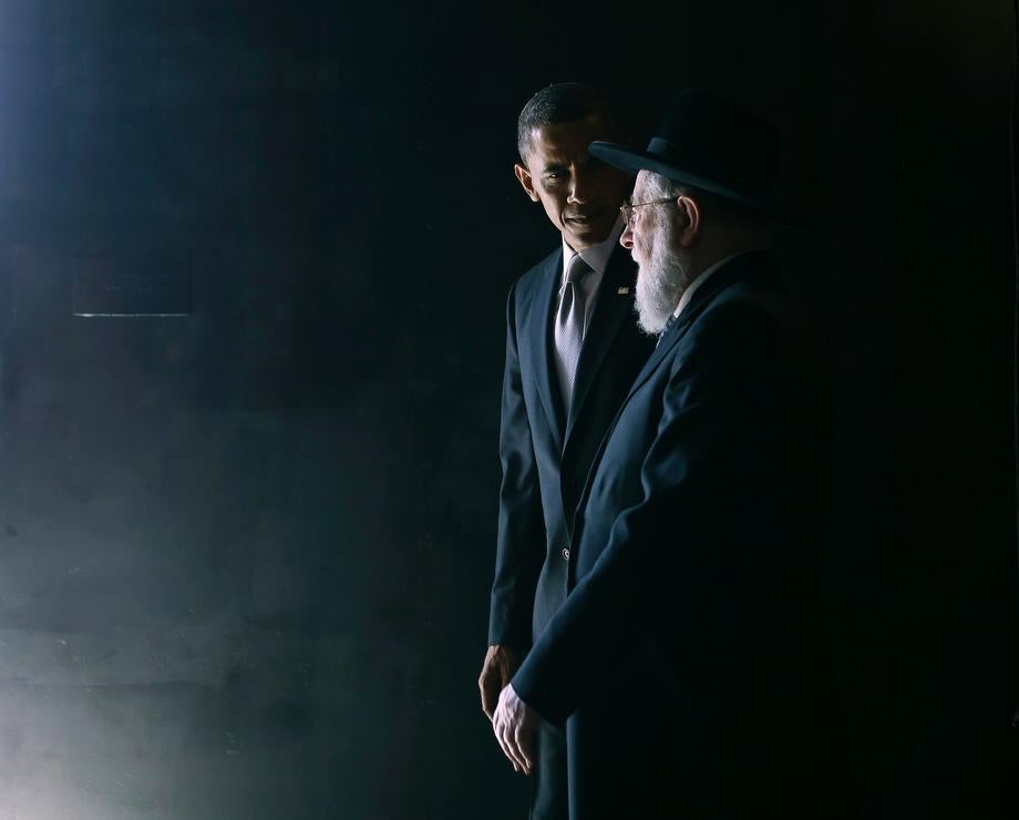 U.S. President Barack Obama walks with Rabbi Israel Meir Lau in the Hall of Remembrance during Obama's visit to the Yad Vashem Holocaust Memorial in Jerusalem on March 22, 2013.