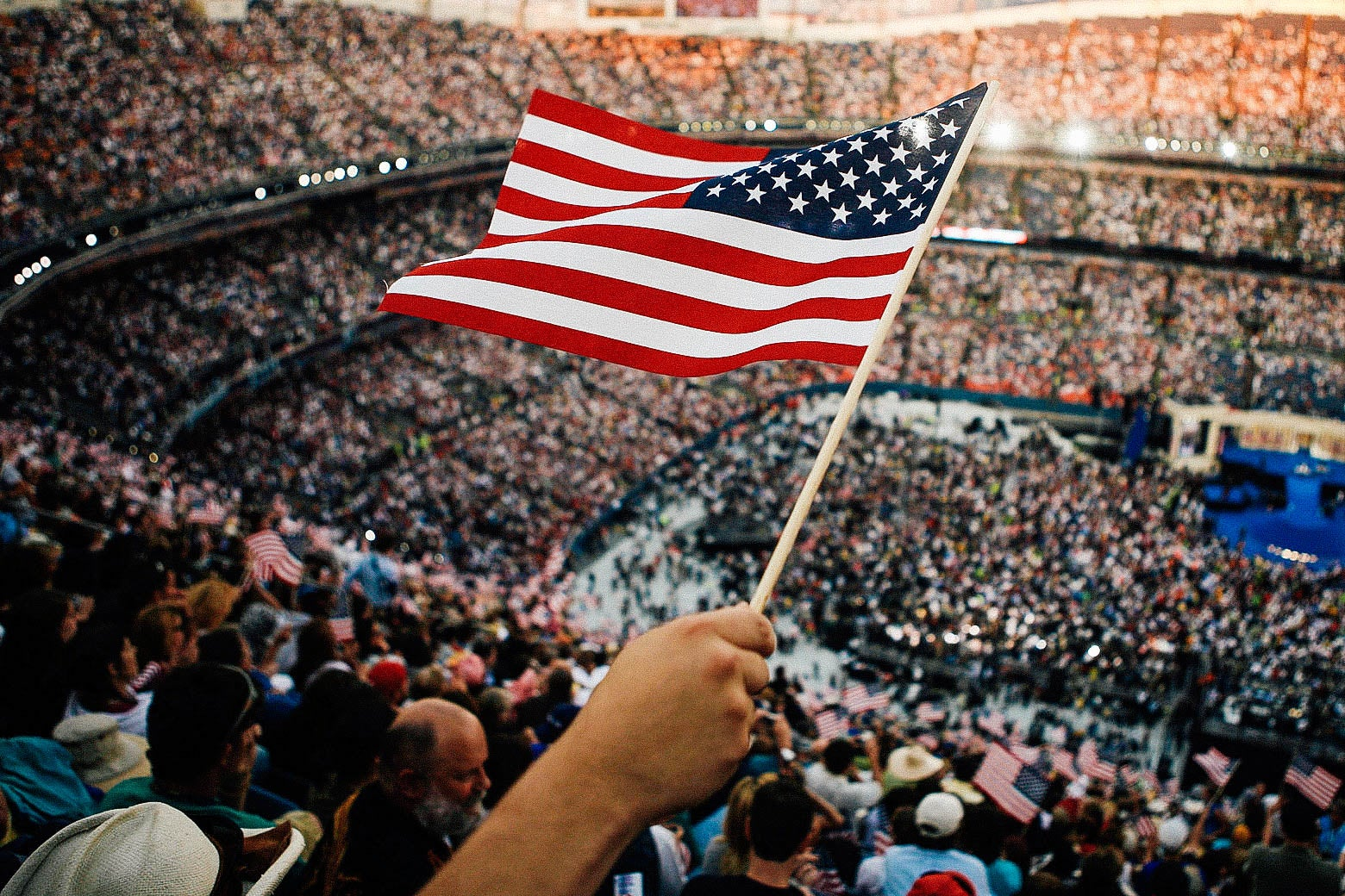 A person holding the American flag at the 2008 Democratic National Convention.