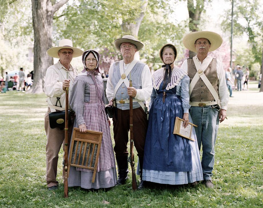 Every year, the state of Utah celebrates Pioneer Day on July 24th in honor of the Mormon pioneers that settled the Salt Lake Valley in the mid 1800s. Here, people dressed as pioneers pose after participating in the annual parade that makes its way through downtown Salt Lake City.