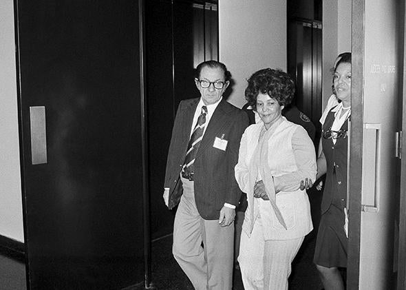 Linda Taylor, 40, walks with her attorney T. Lee Boyd as they leave the Chicago Civic Center Tuesday, March 8, 1977 during a recess in her trial.