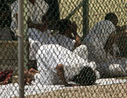 Guantanamo detainees praying. Click image to expand.