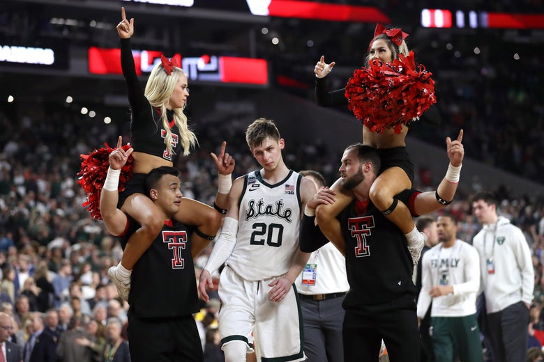 MINNEAPOLIS, MINNESOTA - APRIL 06: Matt McQuaid #20 of the Michigan State Spartans walks past Texas Tech Red Raiders cheerleaders after being defeated by the Red Raiders 61-51 during the 2019 NCAA Final Four semifinal at U.S. Bank Stadium on April 6, 2019 in Minneapolis, Minnesota. (Photo by Streeter Lecka/Getty Images)