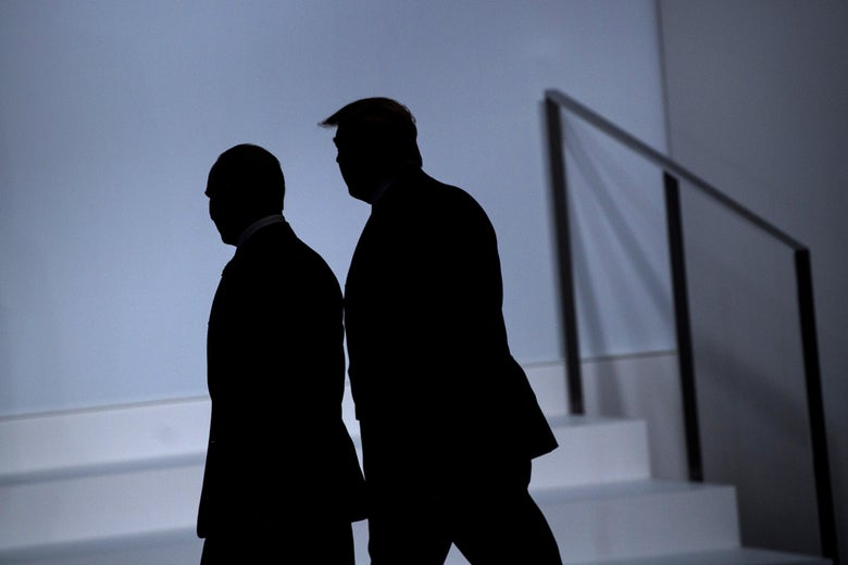 Trump and Putin walking together, seen in silhouette.