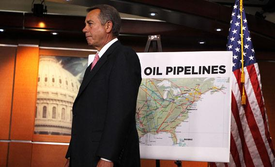 U.S. Speaker of the House Rep. John Boehner (R-OH) stands next to a map of current oil pipelines during a news conference.