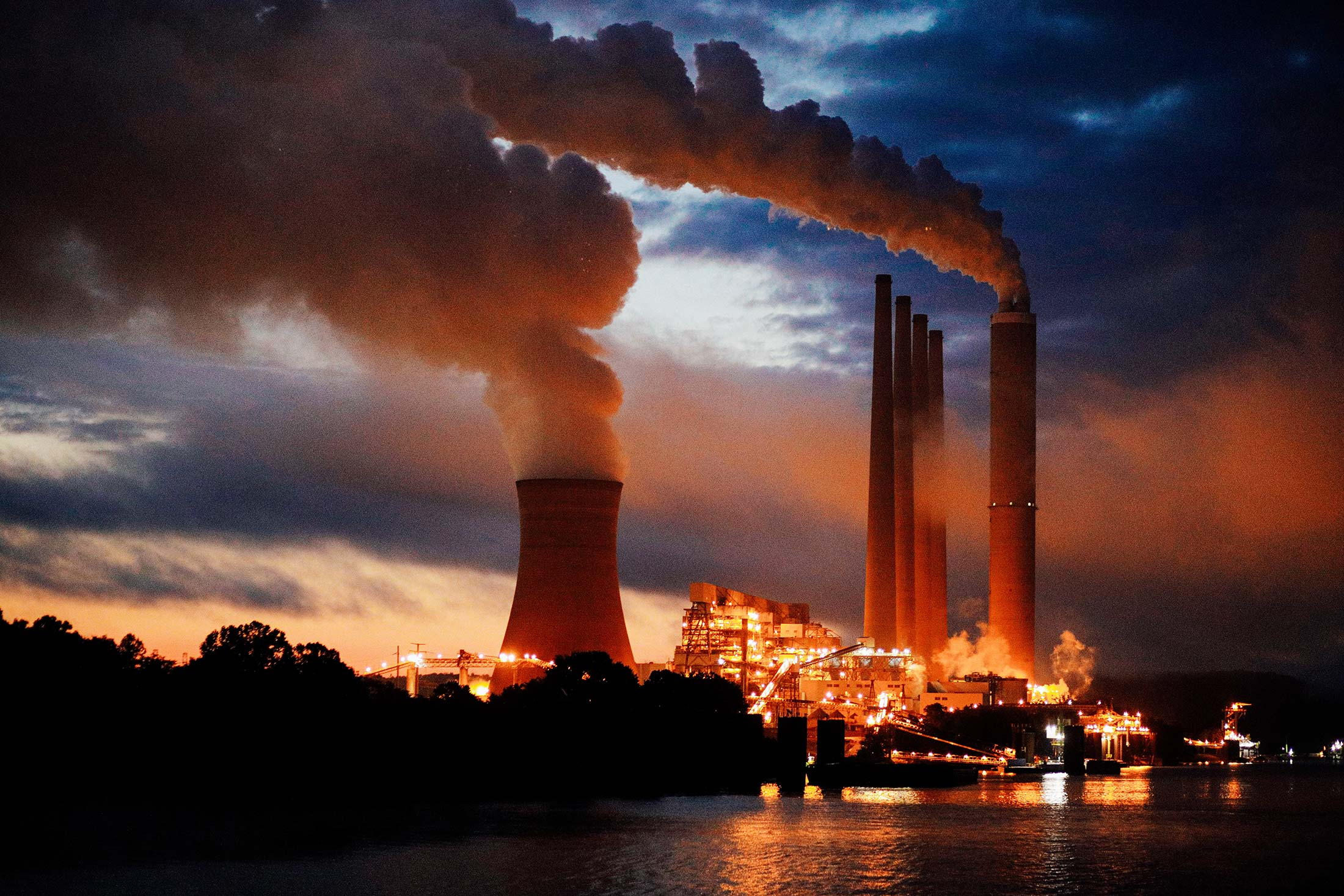 Coal-fired power plant lights up the early morning sky on the banks of the Ohio River.