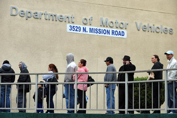 People wait in line outside of the State of California Department of Motor Vehicles in Los Angeles, California on February 13, 2009.