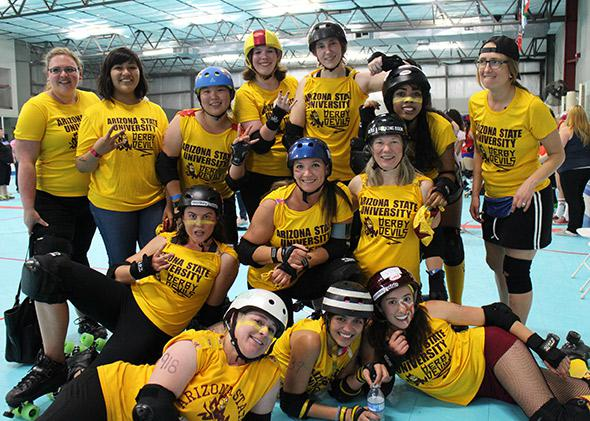 The Arizona State University Derby Devils. The author, aka Stone Cold Jane Austen, is in the second row, kneeling, furthest to the right.
