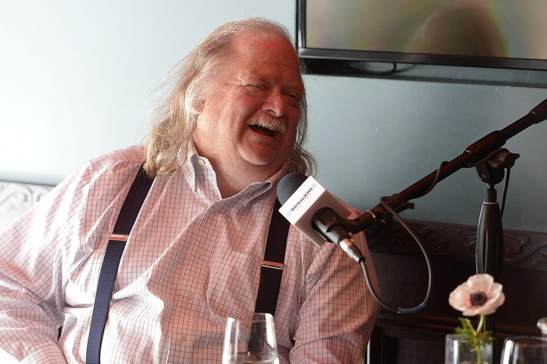 Food critic Jonathan Gold laughing during a radio interview.