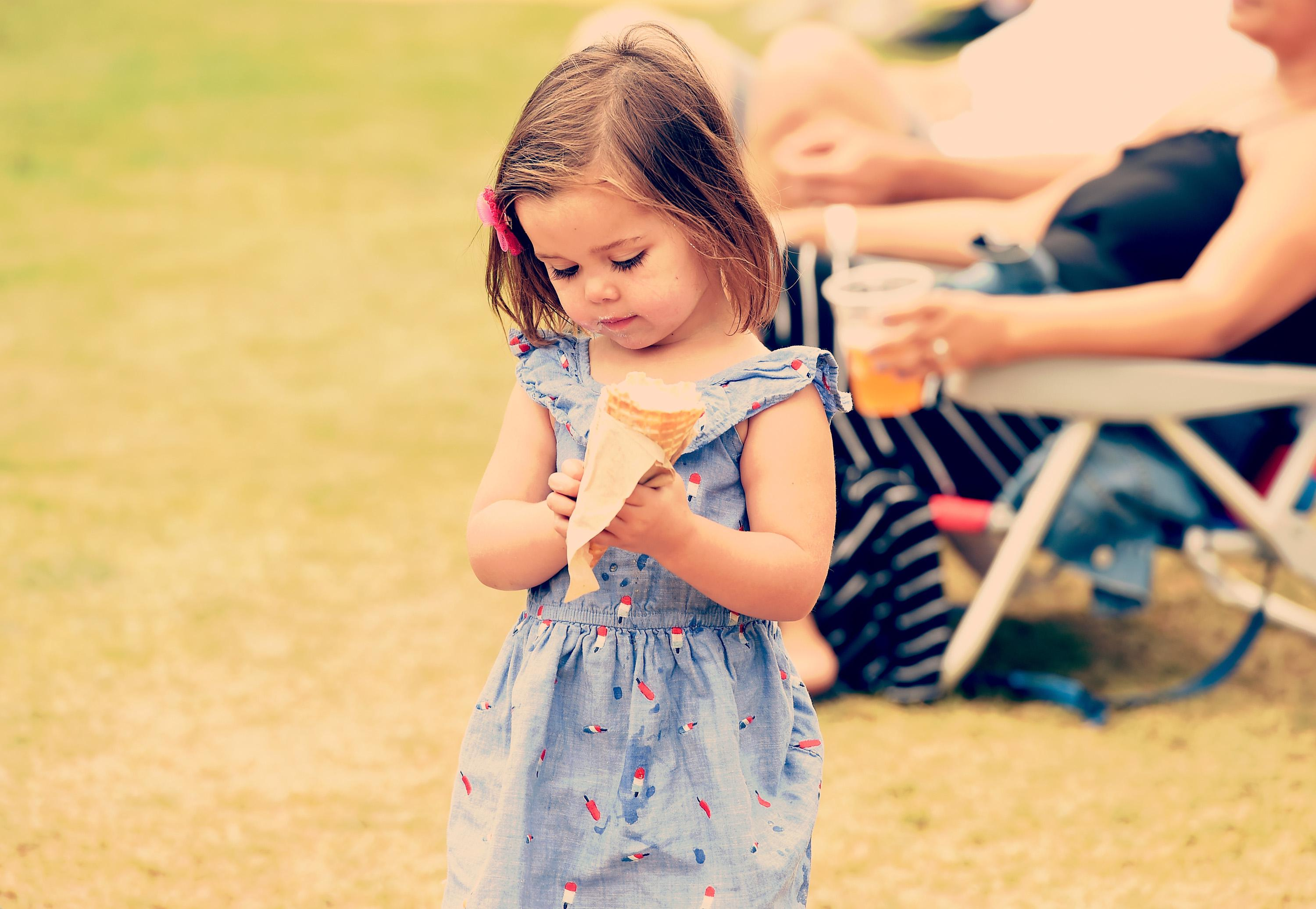 Festival goer eating ice cream at Arroyo Seco Weekend at the Brookside Golf Course at on June 24, 2017 in Pasadena, California.
