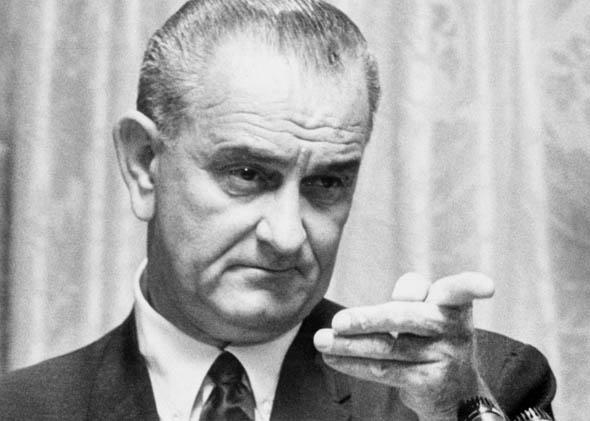US President Lyndon B. Johnson delivers a speech 28 July 1965 in the White House in Washington, D.C., about US policy in the Vietnam war, ordering more US troops to Vietnam.