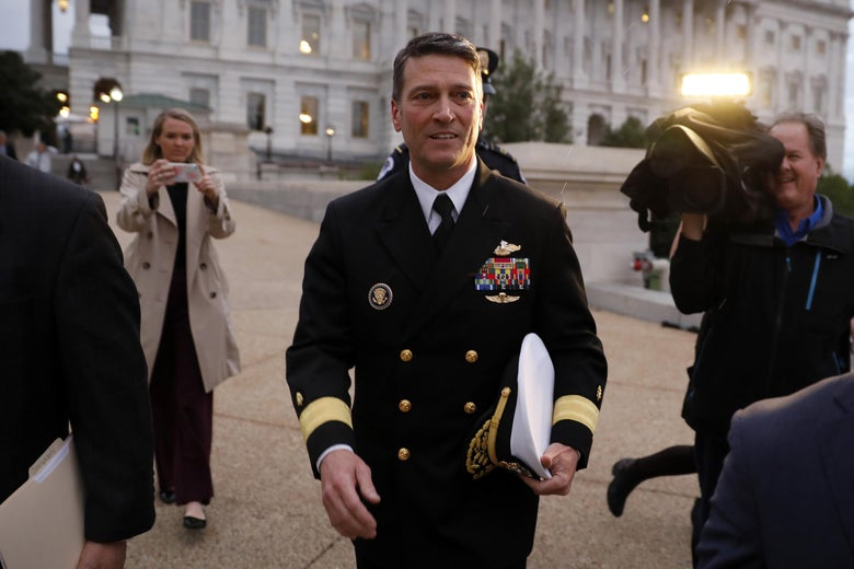 Admiral Ronny Jackson in uniform leaving the U.S. Capitol