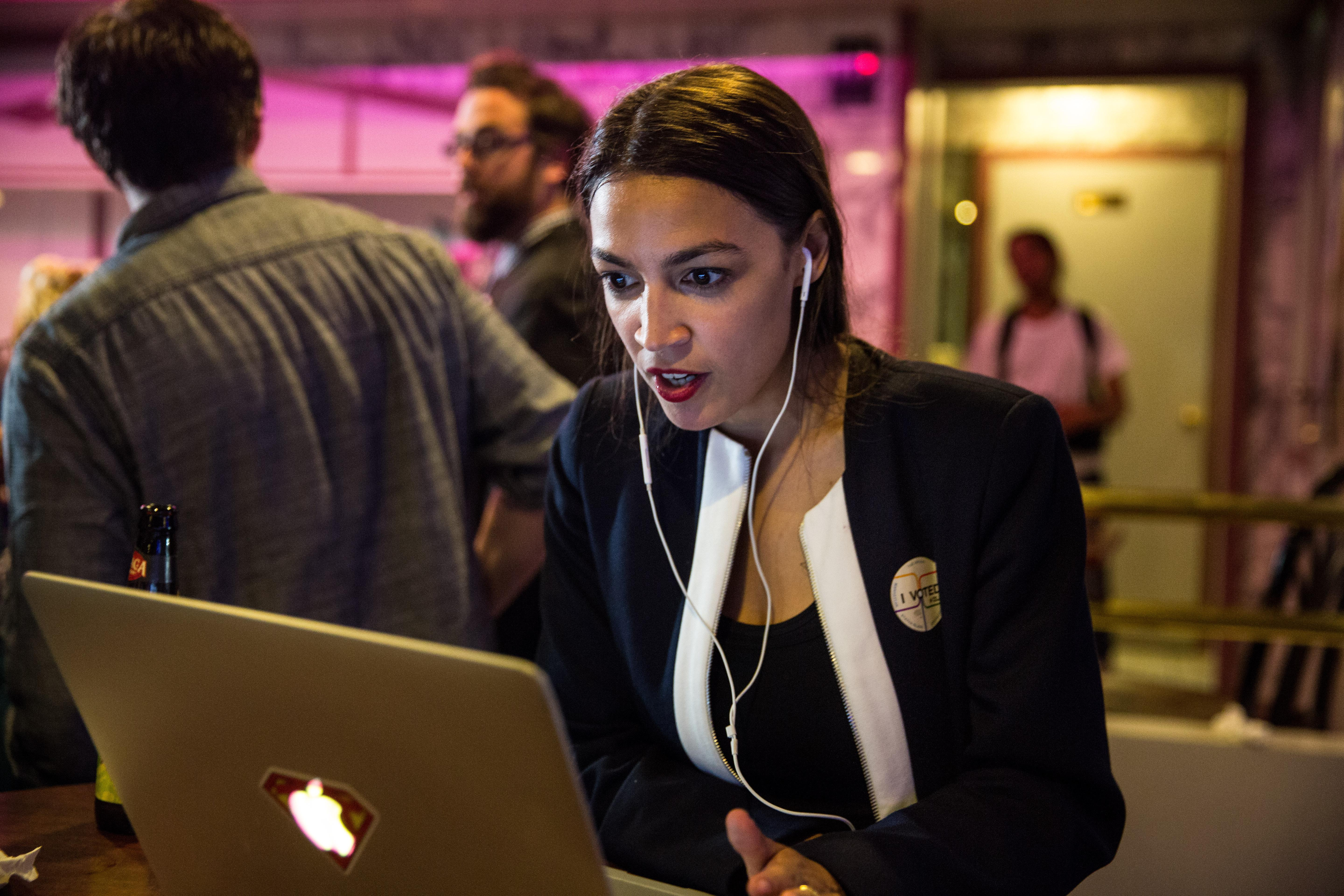 Alexandria Ocasio-Cortez celebrates  at her victory party in the Bronx.