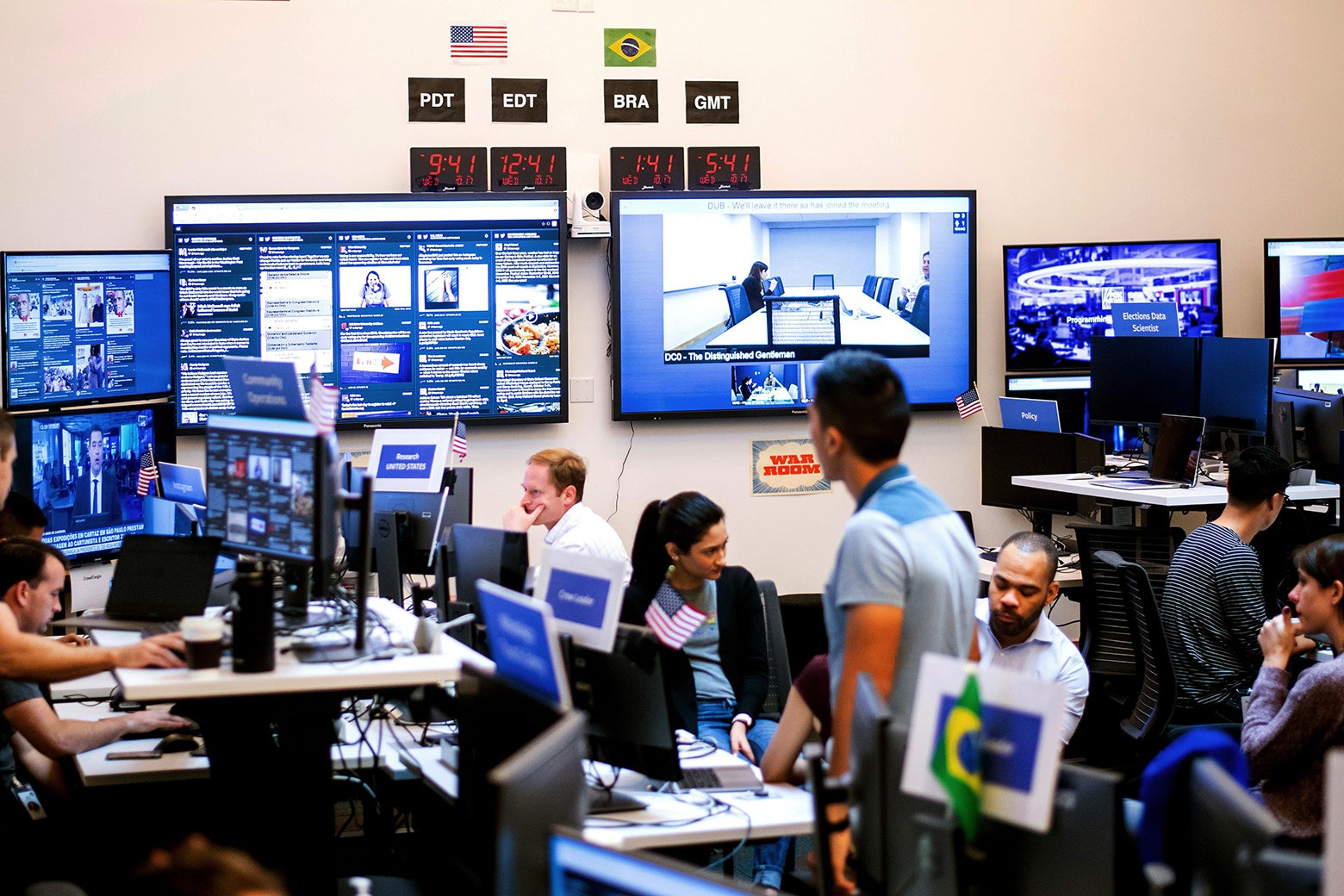 "Employees work in Facebook's ""War Room"" during a media demonstration."