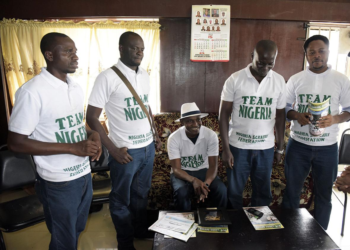Nigeria's new World English-language Scrabble Champion Wellington Jighere gathers with his teammates in Lagos on November 10, 2015.