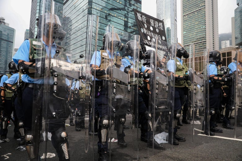 Police stand ready to use tear gas on protestors in Hong Kong.
