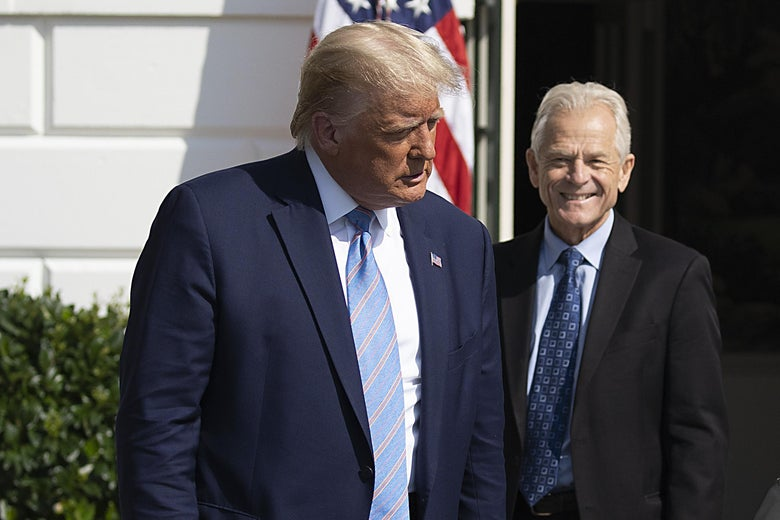 Navarro smiles, standing near Trump outside
