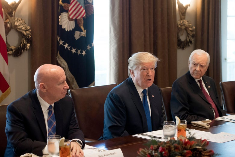 US President Donald Trump speaks about tax reform legislation during a lunch with lawmakers working on the tax reform conference committee, including Senator Orrin Hatch (R), Republican of Utah, and Representative Kevin Brady (L), Republican of Texas, in the Cabinet Room at the White House in Washington, DC, December 13, 2017. / AFP PHOTO / SAUL LOEB        (Photo credit should read SAUL LOEB/AFP/Getty Images)