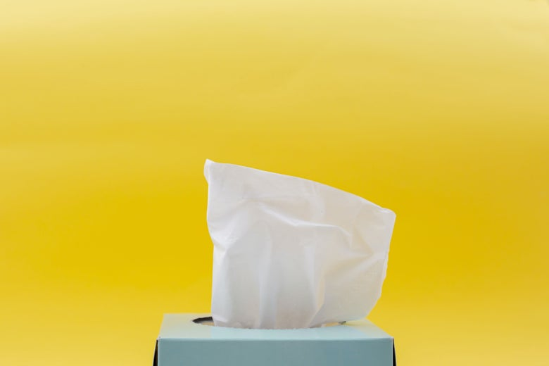 a blue tissue box on a yellow background