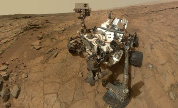 "NASA's Mars rover Curiosity's self-portrait combines dozens of exposures during the 177th Martian day, or sol, of Curiosity's work on Mars, Feb. 3, 2013. The rover is positioned at a patch of flat outcrop called ""John Klein,"" which was selected as the site for the first rock-drilling activities by Curiosity."