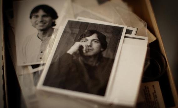 A box of old photos belonging to Michael Quinn at his home.