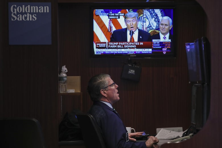 President Donald Trump is displayed on a monitor as a trader works at his desk ahead of the closing bell on the floor to he New York Stock Exchange (NYSE) on December 20, 2018 in New York City.