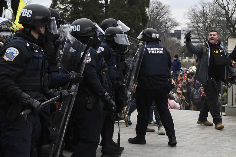 Trump supporters face off with police and security forces in front of the U.S. Capitol in Washington DC on January 6, 2021.