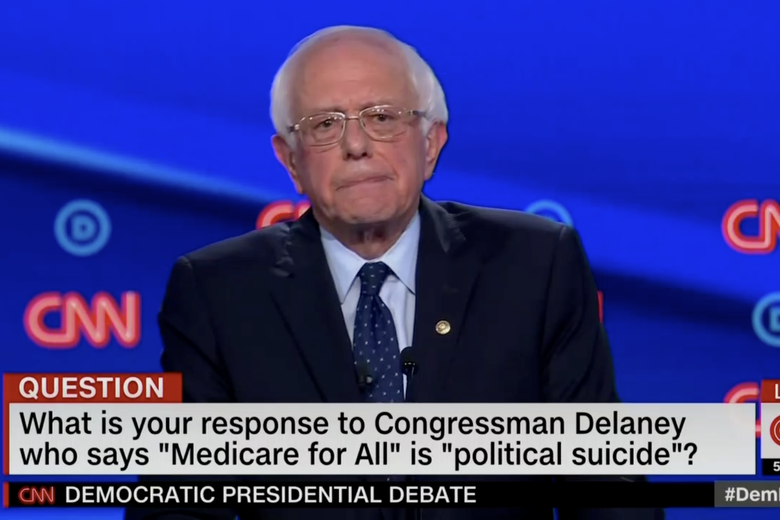 "In this screengrab from CNN, Bernie Sanders prepares to answer a question during Tuesday night's debate. The banner reads: What is your response to Congressman Delaney who says ""Medicare for All"" is ""political suicide""?"