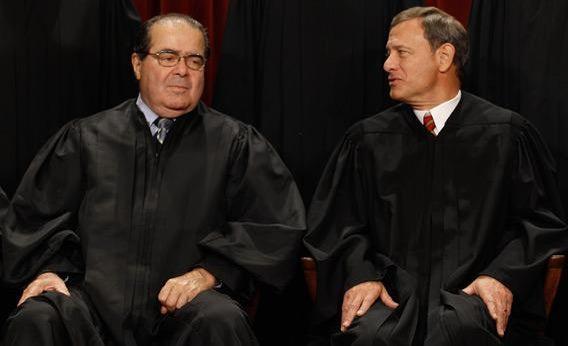 U.S. Supreme Court Associate Justice Antonin Scalia (L) and Chief Justice John Roberts.