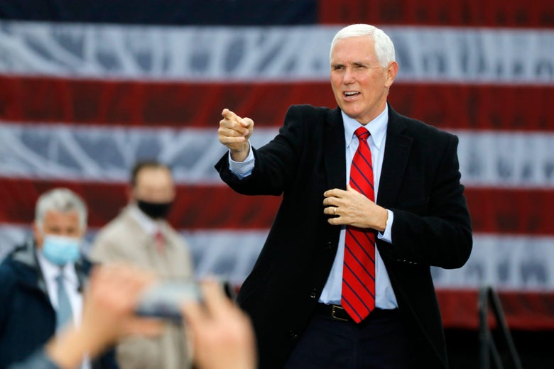 Vice President Mike Pence walks on stage at a campaign rally at Oakland County International Airport in Waterford, Michigan, on October 22, 2020.