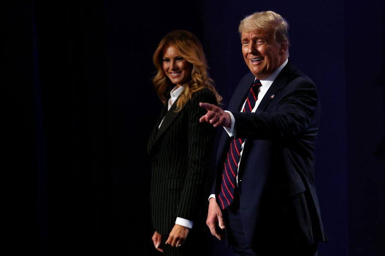 Trump pointing and walking with Melania.