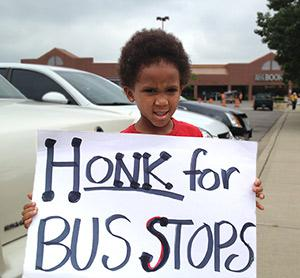 A young Dayton activist rallies for better bus service, June 2013.