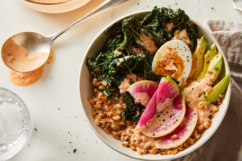 A bowl of quinoa, avocado, and radishes.