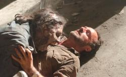 A Walker attacks Rick Grimes (Andrew Lincoln) on The Walking Dead