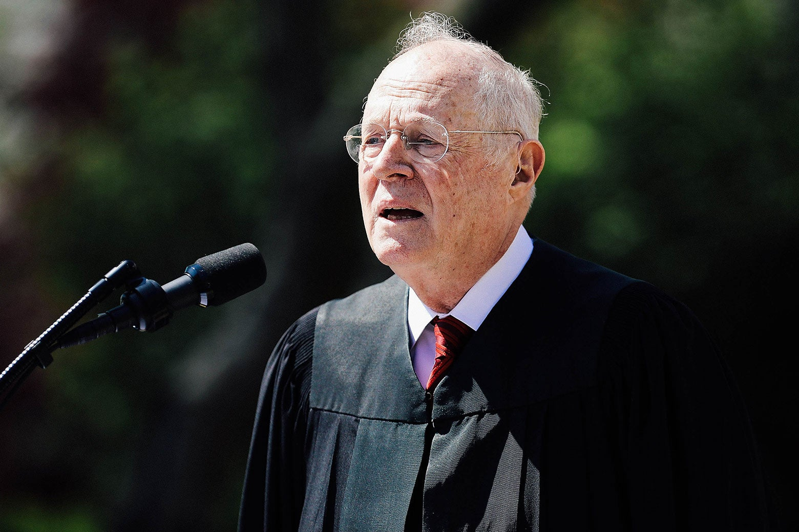 Anthony Kennedy speaking into a microphone