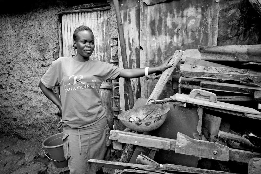 MISS HELEN:  Helen is more beautiful than she perceives herself to be.  She is one of the POHK soapsellers and was instrumental in getting our documentary photos done last July.  I LOVE this picture of her, where she appears to be the mistress of her environment.