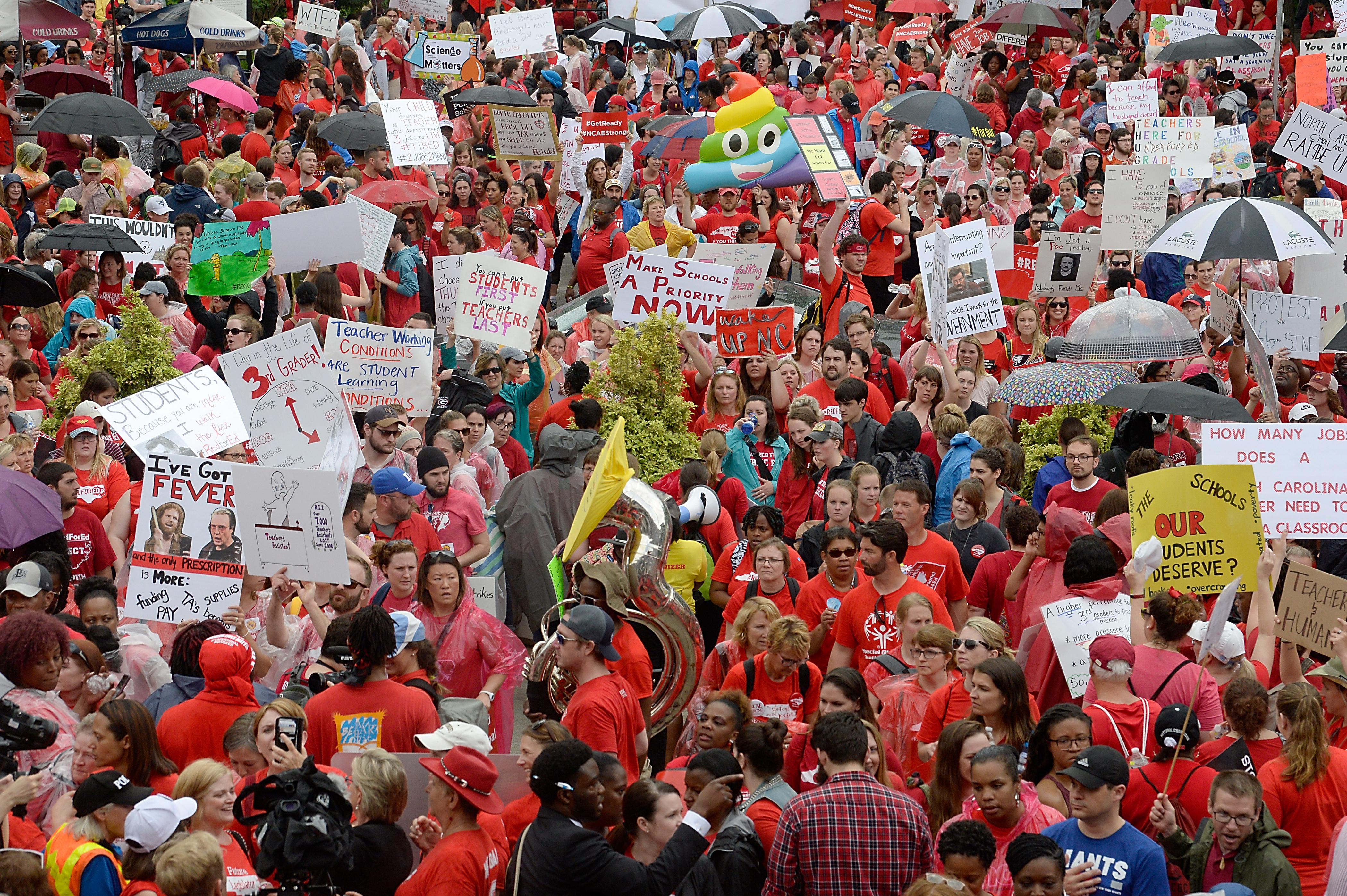 Crowds of teachers and their supporters, many wearing red, at the Capitol.